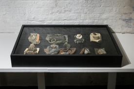"""""""They Say Nothing"""" Objects/artefacts from London Thames foreshore, MDF and glass, 92x55x12cm"""
